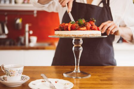 Woman cutting strawberry cake